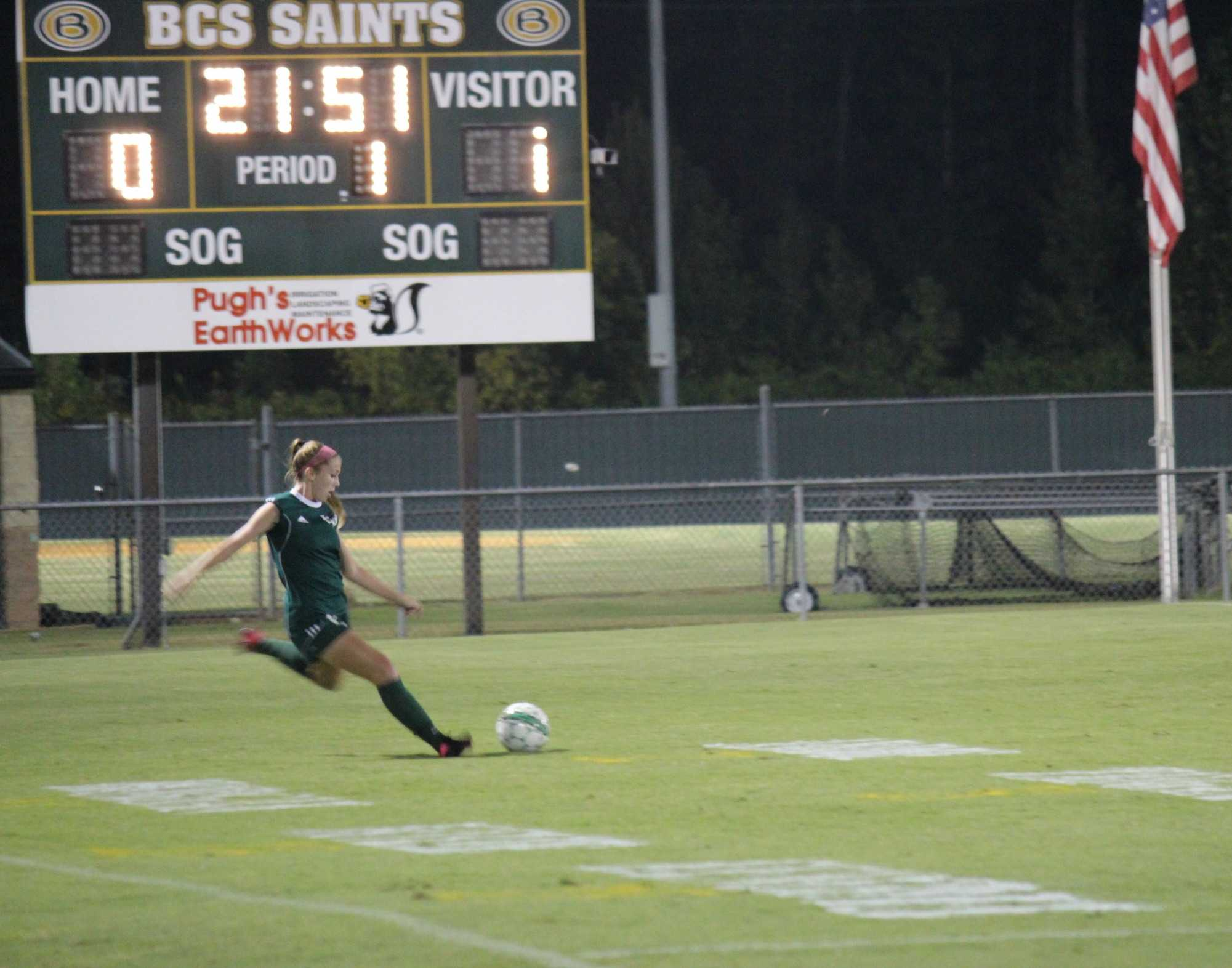 Alex Harber (12) setting up a lob pass to her teammates during a game against Briarcrest
