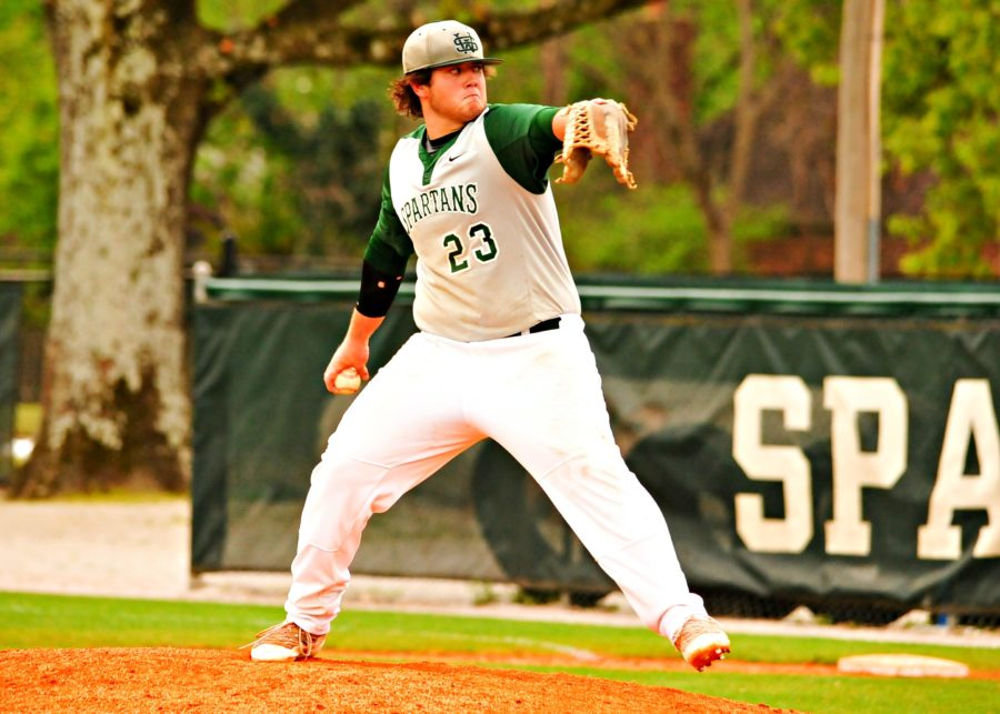 Reed+McGuinn+%2812%29+pitches+a+fastball+during+a+game.%0A