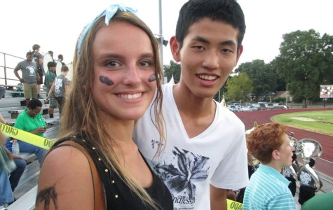 New exchange students Cecile Kessler  and Shunichi Haraguchi cheer on  the Spartan football team at the first home game of the season.