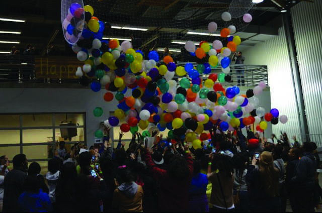 BRIDGES celebrates Martin Luther King's birthday by showering the crowd with balloons.