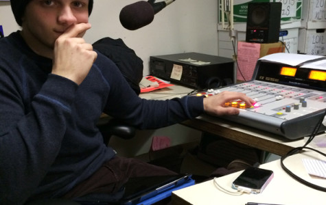 Mabray sits in the WEVL studio as he selects music for his next show. Courtesy of Mallory Prater