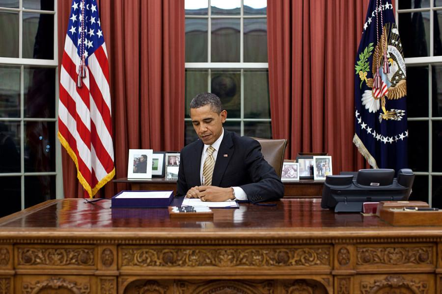 President Obama signs his 2016 executive order gun laws into effect.