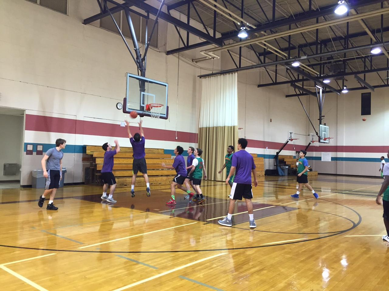 Members of Memphis Sonics and FC Lancaster face off in recreational basketball game.