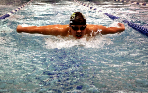 Swimmer Roland Chang (10) showing off his talent at a swim meet.