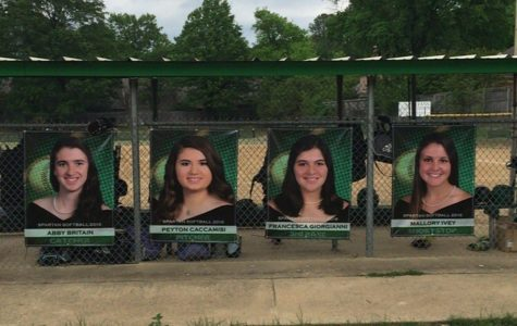Abby Brittain, Peyton Caccamisi, Francesca Giorgianni, and Mallory  Ivey's senior posters on their senior night.