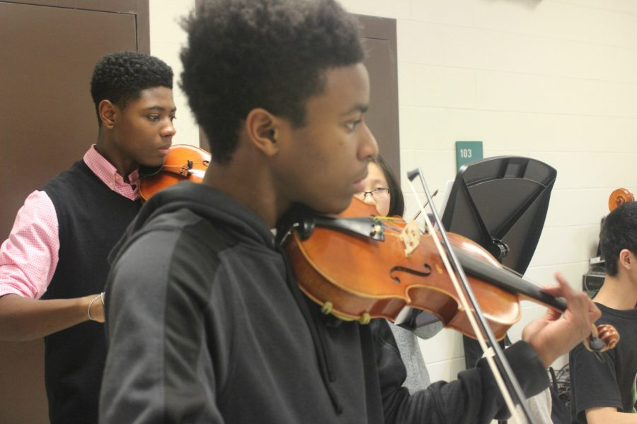 Kyler Hamilton (10) and Charlie Folson (10) practicing All-West music.