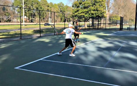 Arvind Ramesh (10) and Coach Jan Waller practicing their strokes during a team practice.
