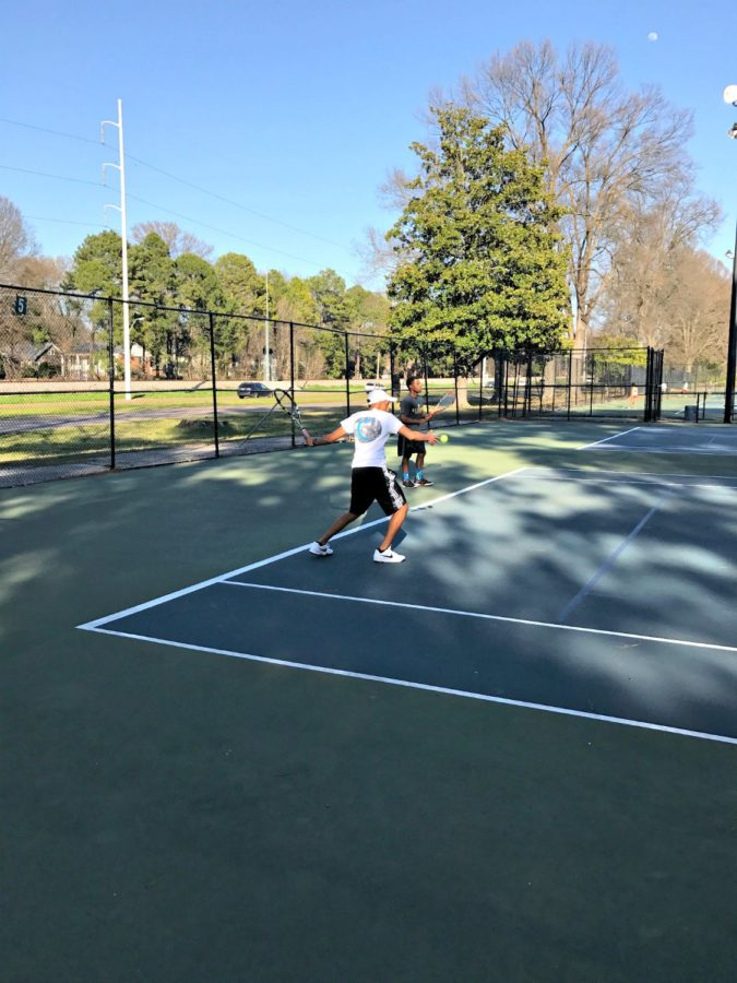 +Arvind+Ramesh+%2810%29+and+Coach+Jan+Waller+practicing+their+strokes+during+a+team+practice.+