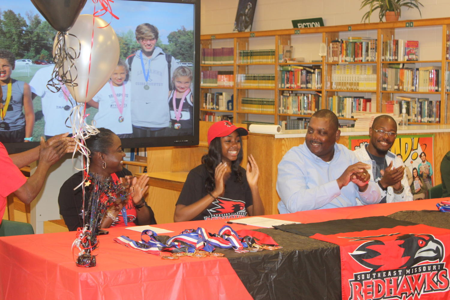 Kendall Long (12) as she signs her NLI to run track and field at Southeast Missouri.