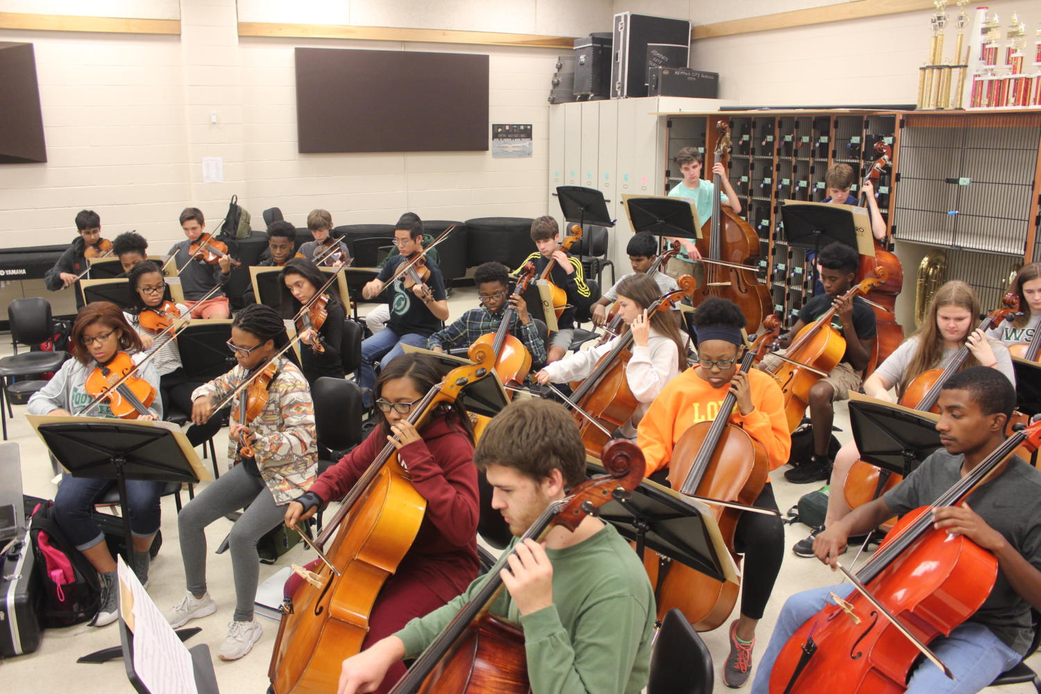 The White Station orchestra rehearsing concert pieces