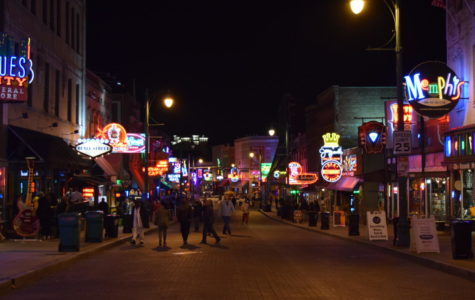 Memphians and visitors enjoy a night out amidst the lights and music of Beale Street.