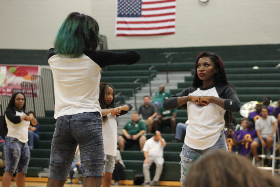 The step team performs at the football pep rally.