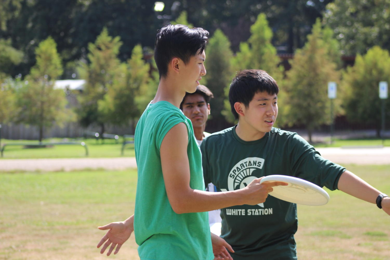 Justin Du (12) coaches Alex Chung (12) during practice at Audubon Park.