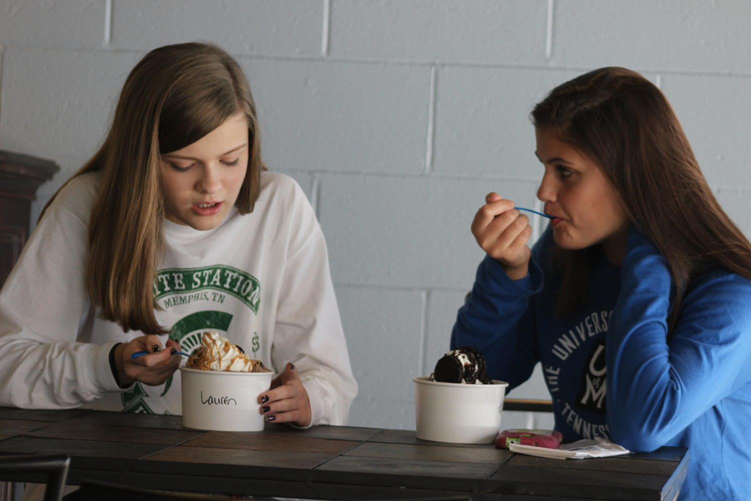 Lauren Carlson (10) and Olivia Ivey (10) have ice cream at The 901  Scoop.