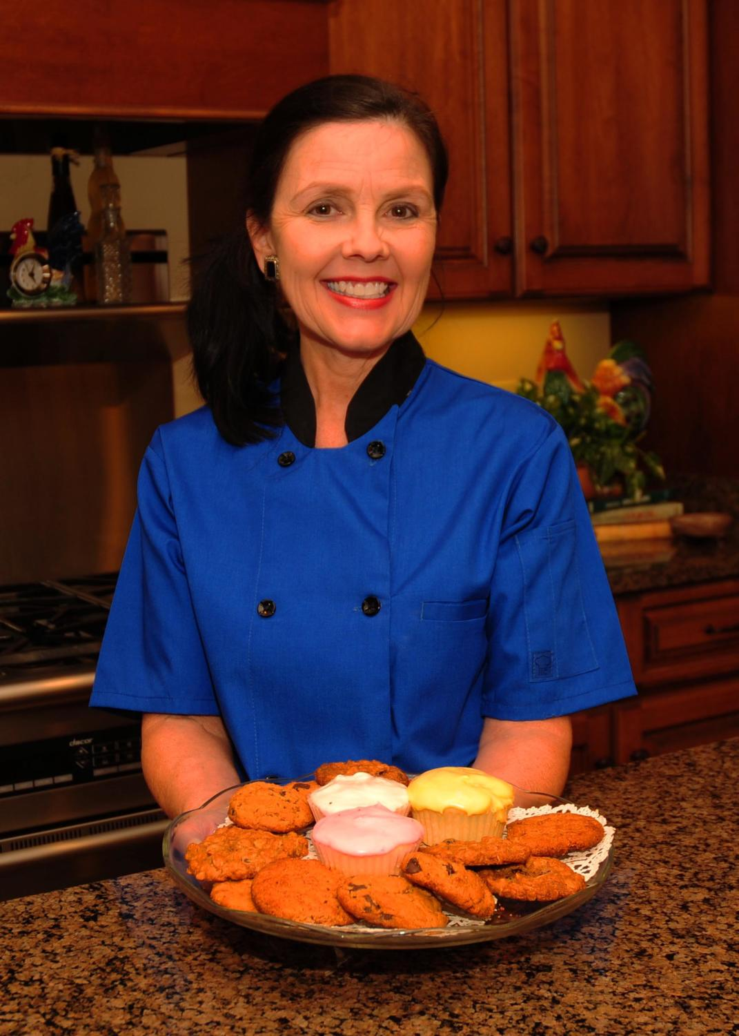 Mrs. Whittington stands in her kitchen with a batch of freshly baked cookies.