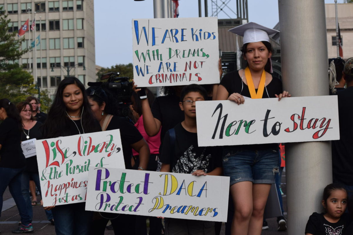 Students+holding+up+signs+at+the+DACA+Vigil+organized+by+Latino+Memphis.%0A