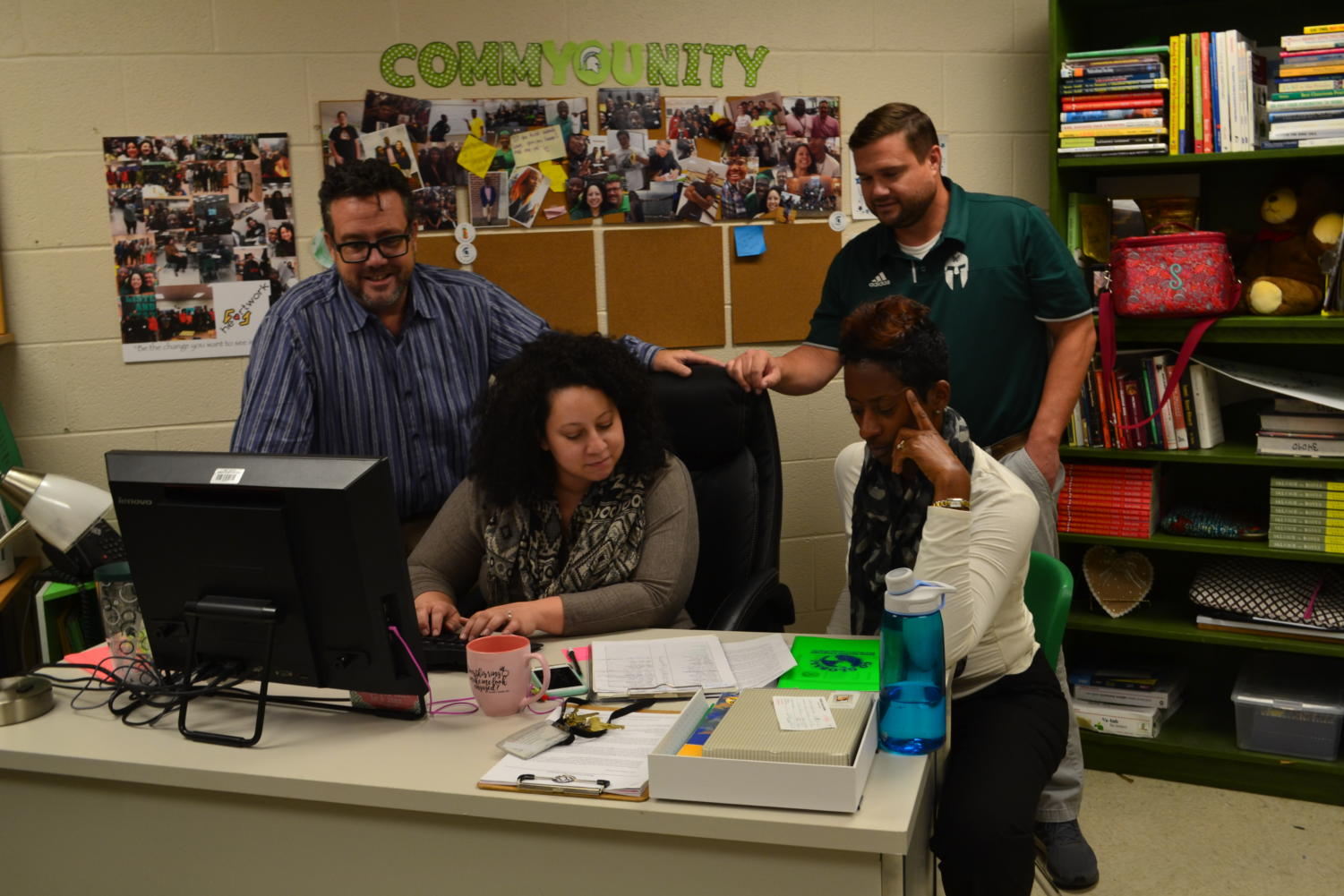 Terry NeSmith, Susan Satar, Tammy Hayes and Marion Smith working on their daily duties.