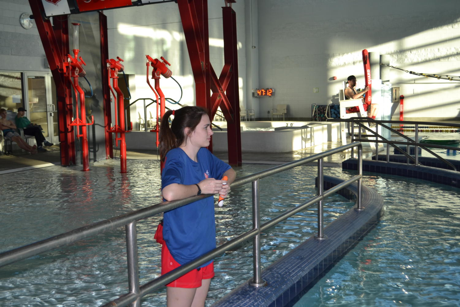 Andrea Brimhall (11) watches to make sure everyone is safe in the pool while on lifeguard duty at the Kroc Center.