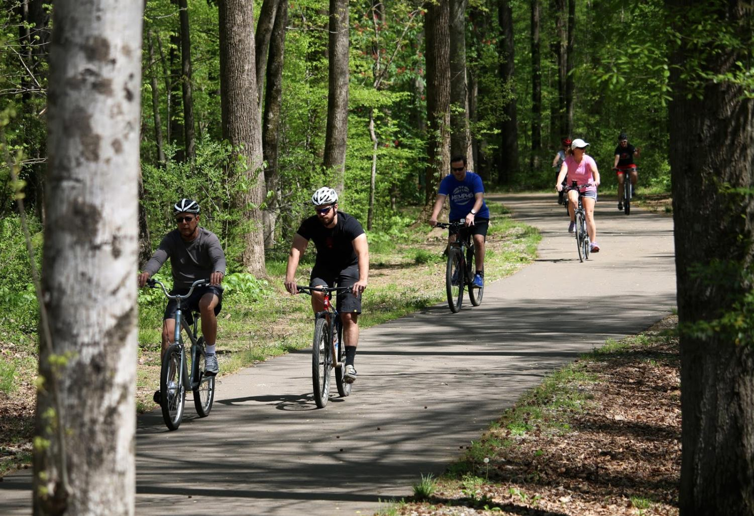 Cyclists biking on the Wolf River Greenway