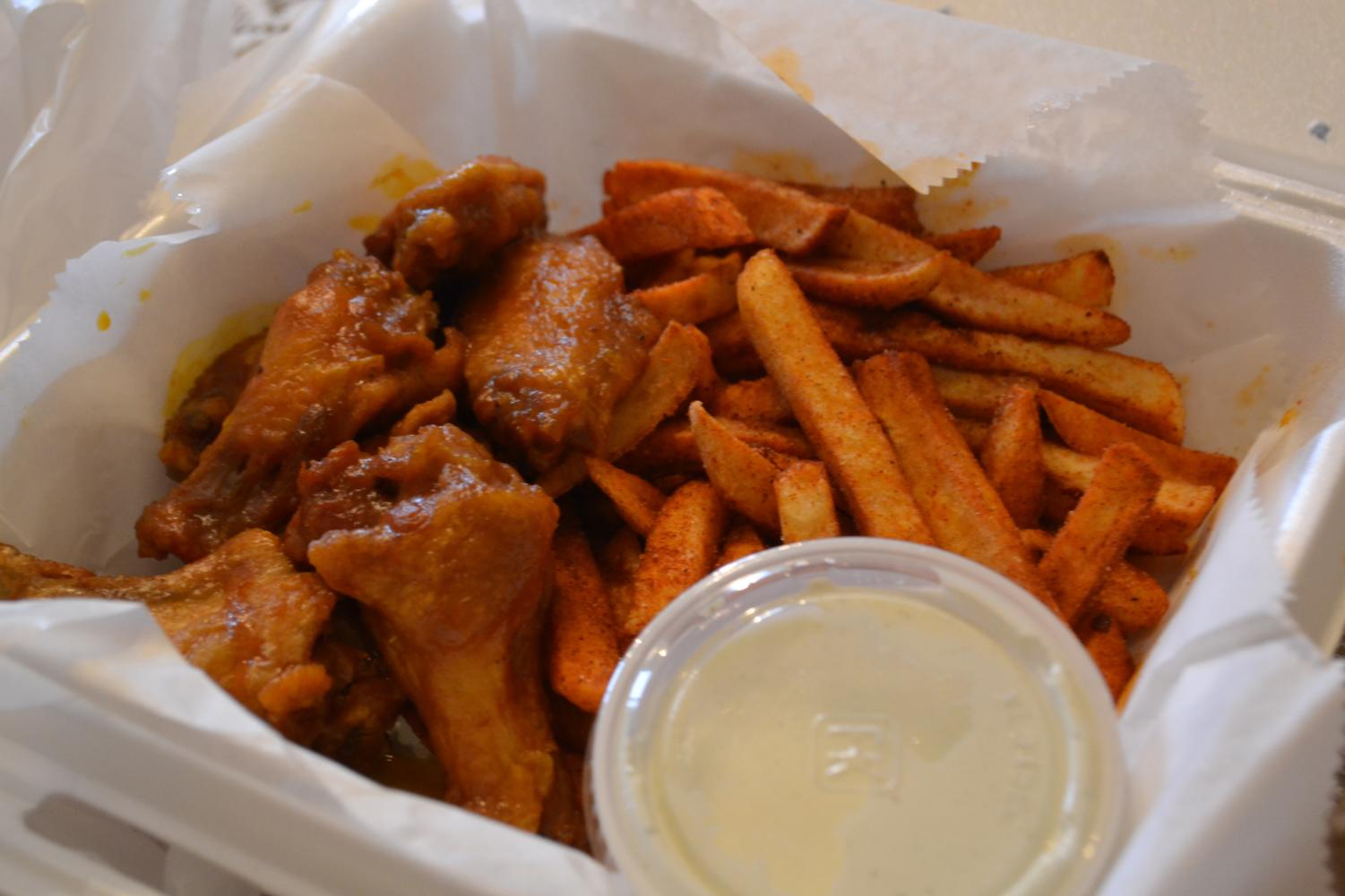 Bosses' honey-hot wing combination takeout order with a side of ranch dipping sauce.
