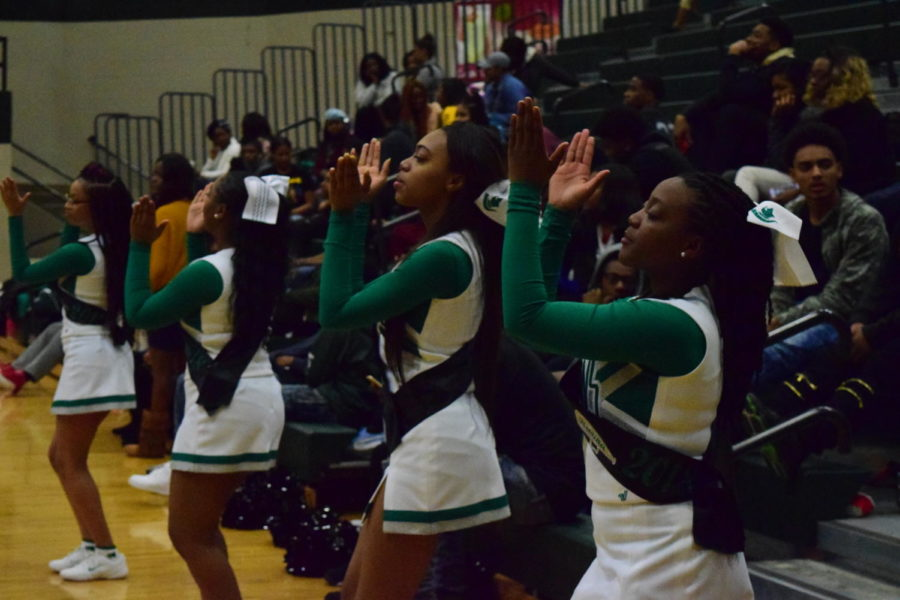 Cheerleaders perform at the game against Whitehaven High School.
