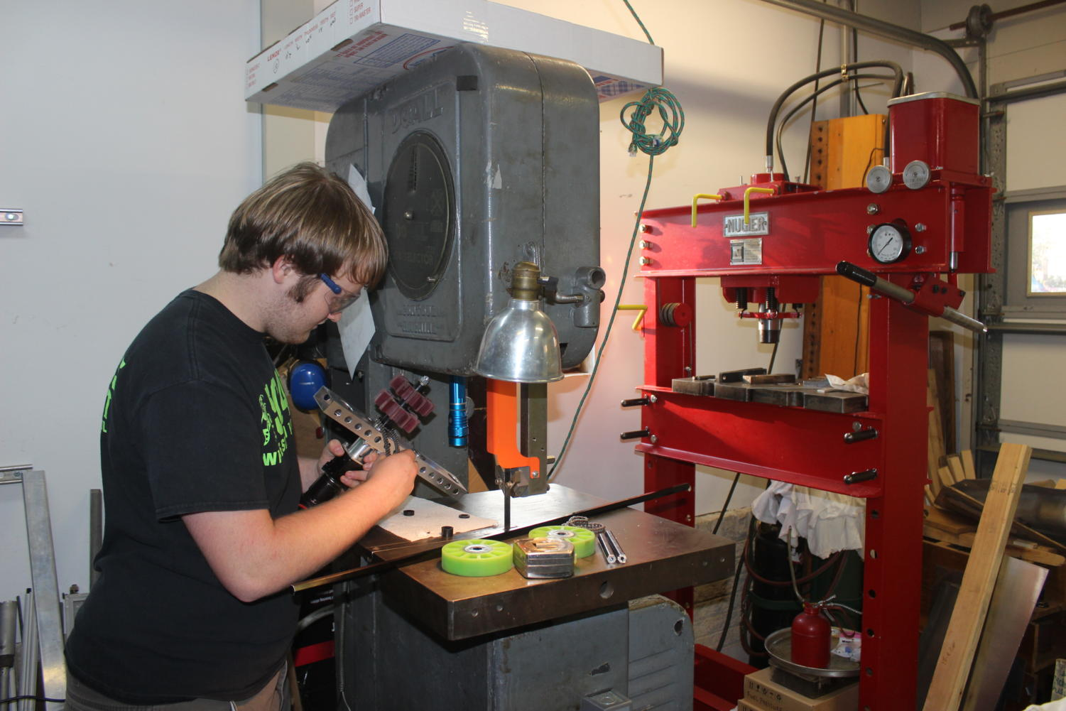 Evans works on building a robot in an MLGW worker's machine shop after school for a competition in Huntsville from March 15 to 17.