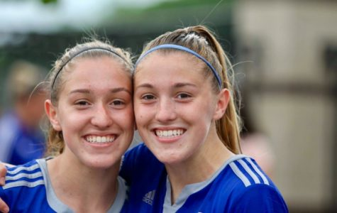 The Duncan sisters pose for a picture after a soccer game with their club, Lobos. The twins have been playing together since age three and committed the University of Memphis mid sophomore year.
