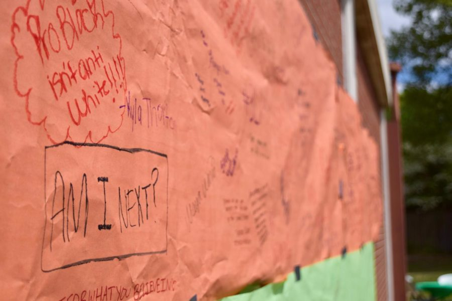 Students+wrote+their+recommendations+and+their+thoughts+on+school+safety+on+the+banner+during+the+walkout.++