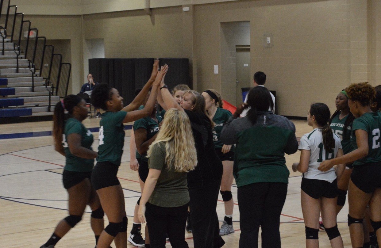 Lady Spartan's Varsity team meet for a huddle to boost morale in the middle of the fourth set.
