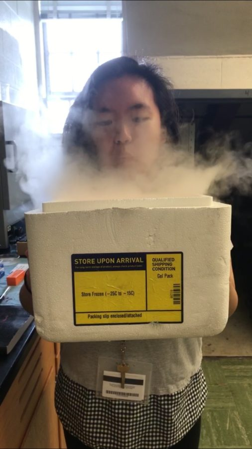 Joanna Xiao (12) experiences laboratory life while she handles liquid nitrogen at the Tennessee Governor's School of Emerging Technologies.