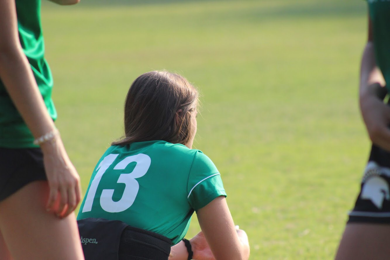 From the sideline, senior Amy Eleogram watches her team competing against the Bartlett Panthers. Due to a spinal injury, Eleogram, one of the varsity captains, is out for half the season. However after attending physical therapy once a week, she will be able to return to the field early September.