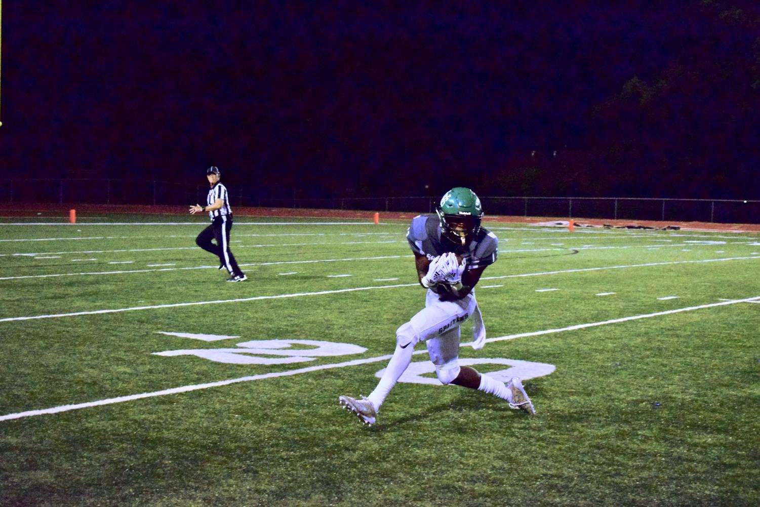 In the fourth quarter, Rod Farmer (12) hauls in a pass from quarterback Drew Lyons (12) on his way to the end zone. Farmer was tackled in the red zone and set Eli Neal (12) up for his second touchdown of the night.