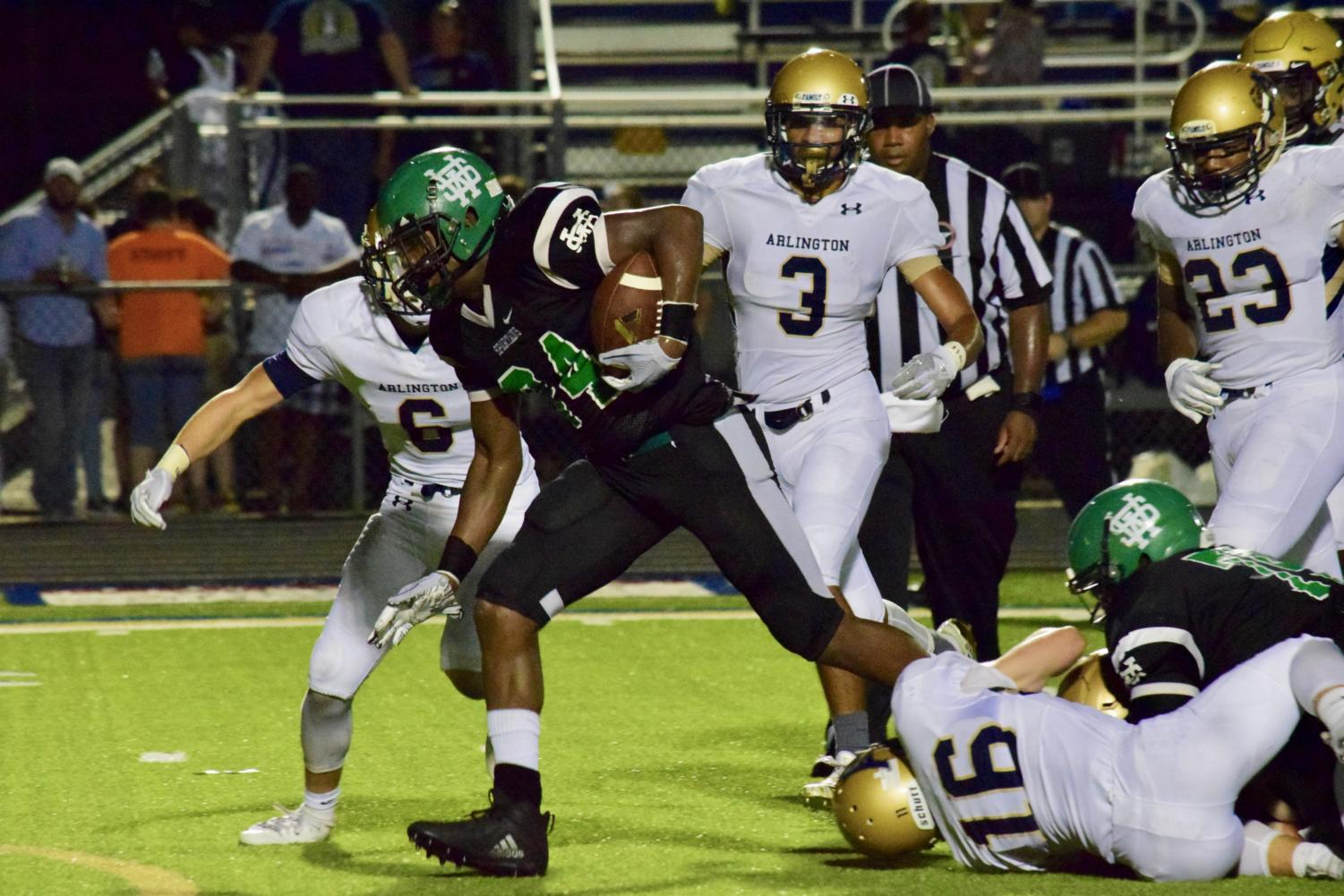 Eli Neal (12) escapes an Arlington defender on his way to the end zone. Neal troubled the Tiger defense all night, ending the game with three touchdowns.
