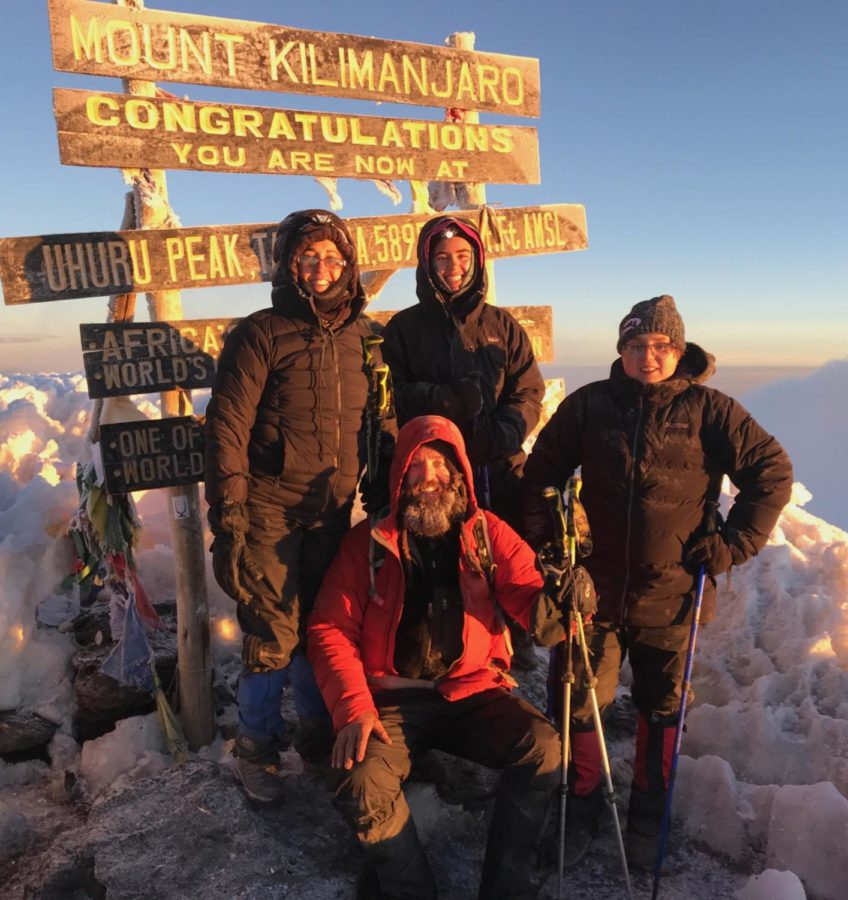 Standing on the summit of Mt. Kilimanjaro, Zoe Wolfe (10) poses with her family after completing the final day's eight mile hike. Wolfe is one of the few Spartans who undertook an intensive hiking experience this summer.