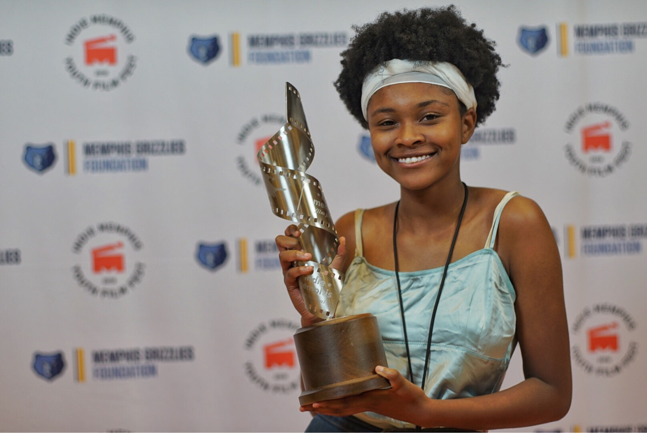 "Kelley (11) excitedly displays the Grand Jury Prize for her film ""The Death of Hip Hop."""
