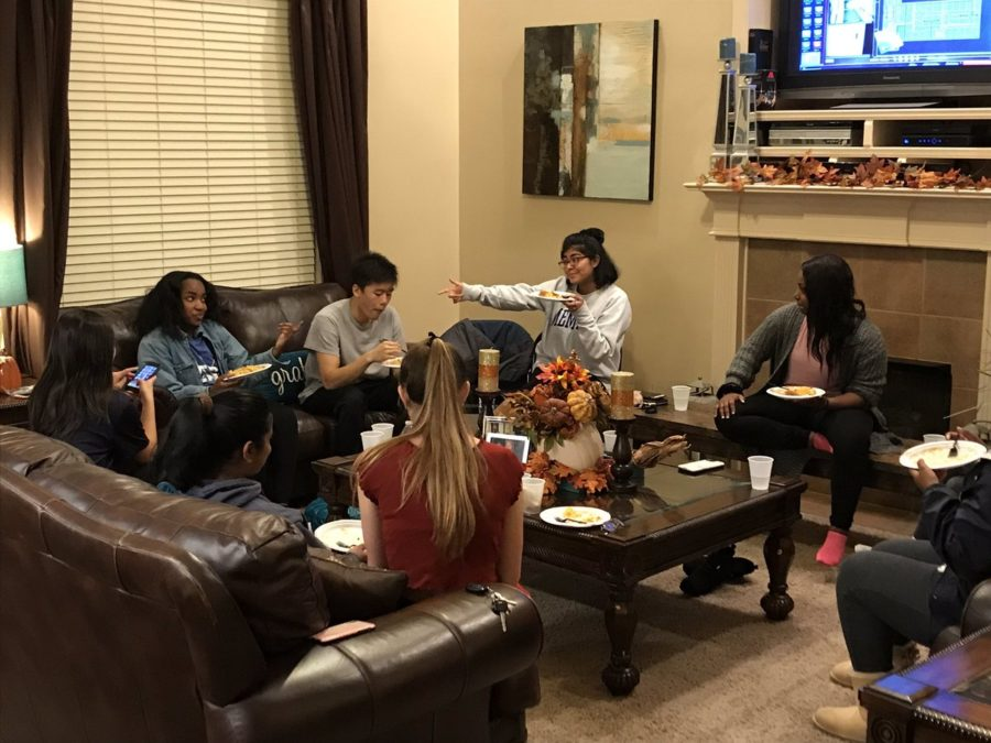 Thirteen members of the Executive Board casually gather and break bread together in celebration of Friendsgiving.  The annual event was hosted by Commissioner of Publicity Kennedy Ray (11) and her family.