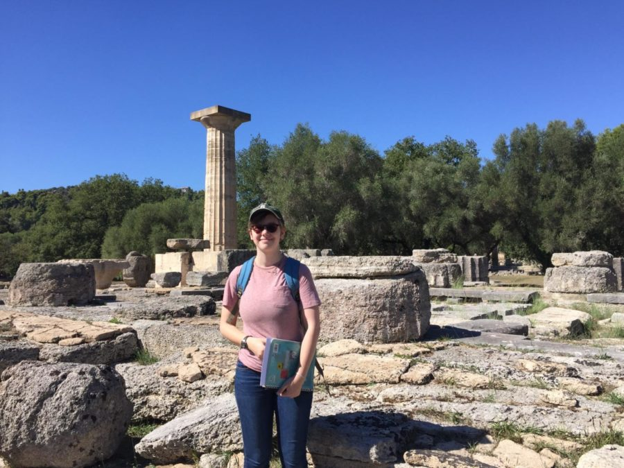 Evvia Townley-Bakewell (11) smiles as she stands in front of the Temple of Zeus in Olympia. She spent last year exploring places like this in Greece with her father.