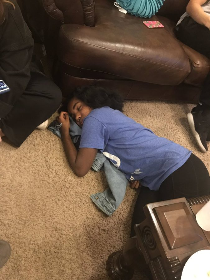E-Board President Emille Taylor (12) slumps over after eating.