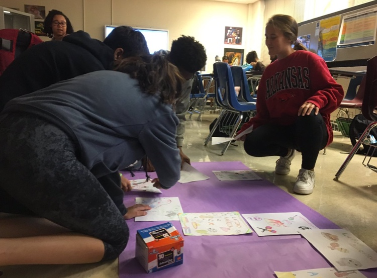 Spanish three students work on a poster as a part of their Latinoamerica project. This project was assigned to students in order for them to gain more cultural insight on Latin American countries.