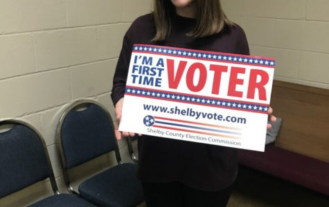 After voting for the first time, Zoe Woody (12) proudly holds the first time voter sign.