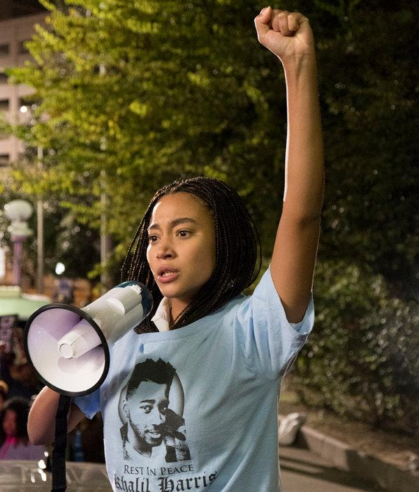 Starr Carter, played by Amandla Stenberg, raises her voice for her friend Khalil Harris who was shot by a white police officer. This scene is part of the climax of the movie.