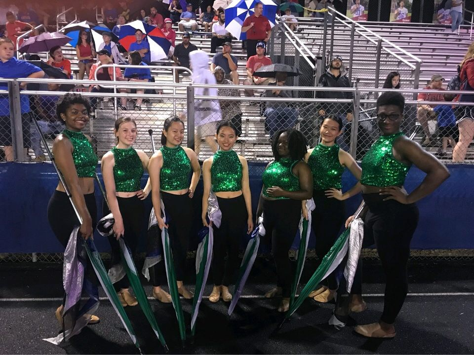 The color guard team, composed of 7 members, performs at Friday night football games alongside the marching band. The captains of the team are sisters, Brandy and Molly Yuan.