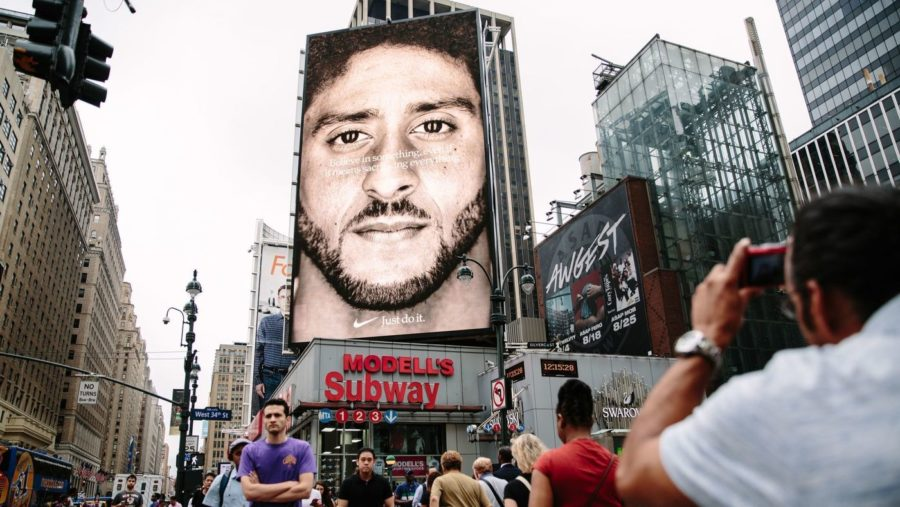Nike's advertising spans the globe, and the controversial Colin Kaepernick ad is no different. Pedestrians and drivers in downtown Manhattan are treated to an image of the football player's face and a quote from the video.