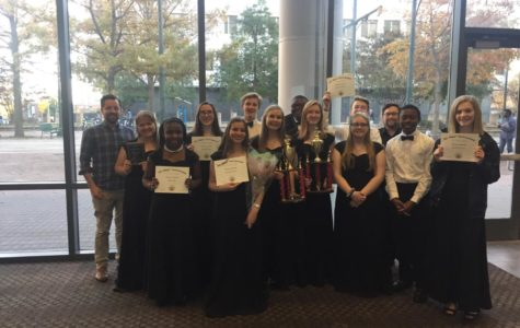The Spartan singers, some with four, five, or six year awards pose for a picture after the concert.