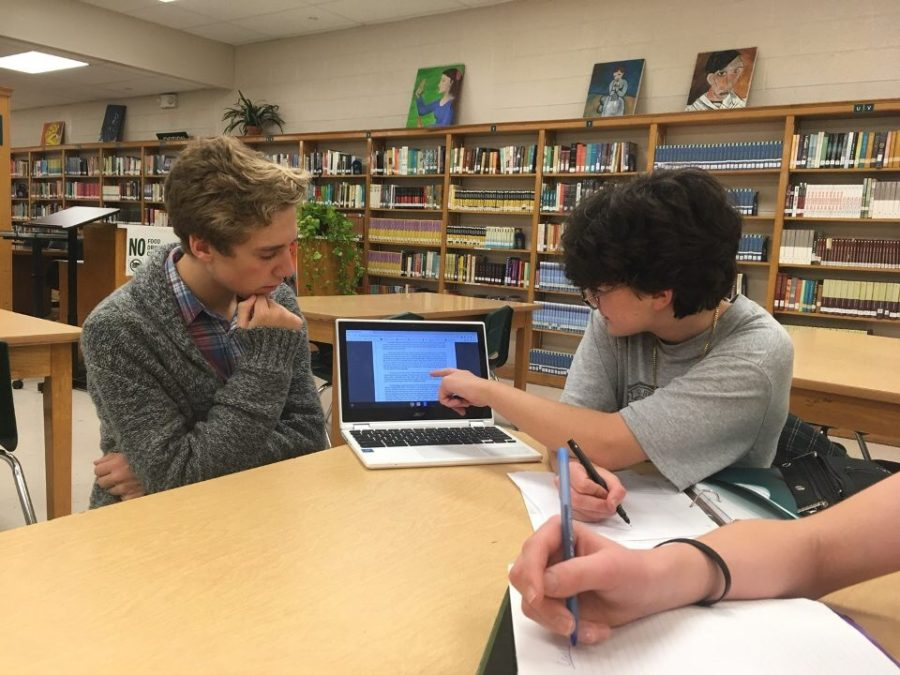 Emmett Campbell (10) and Ryan Mesler (9) discuss a witness for the Mock Trial competition.