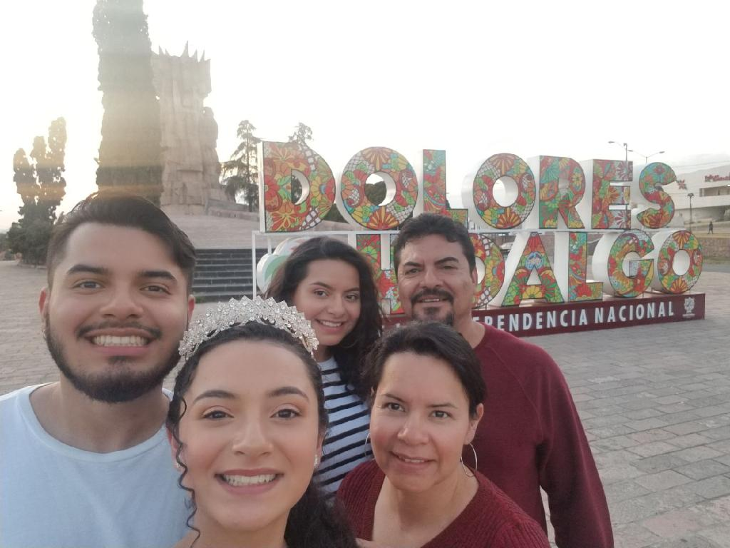 Karely Rodriguez (11) and her family pause to take a picture in front of the entrance to Dolores Hidalgo, Mexico, the city they are visiting to celebrate Karely's sister 's quinceañera.