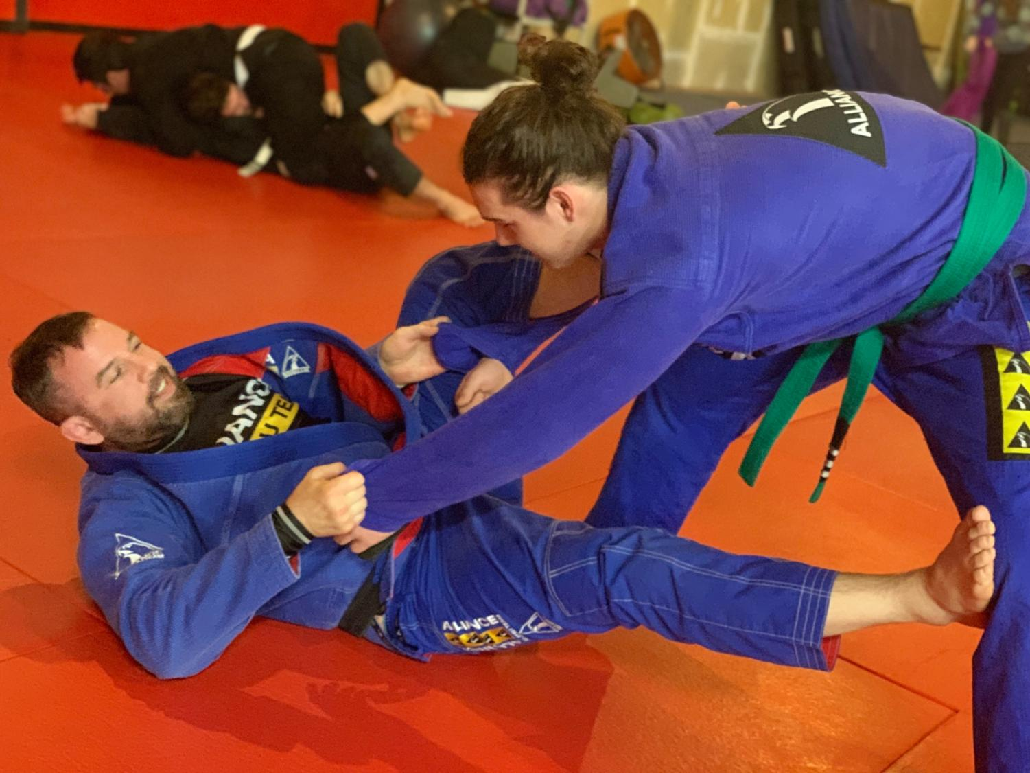 During practice, Merrick Miller spars with his instructor, Alex Sensei, at the Midtown Grappling Academy.