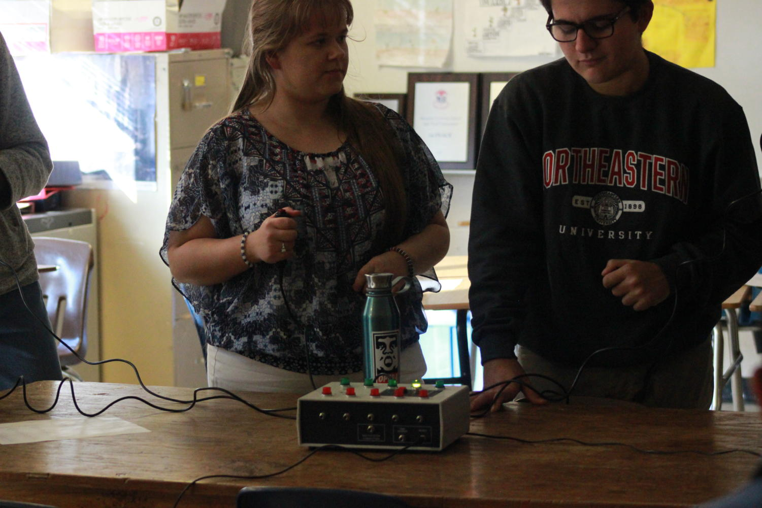 Tara Sandlin (12) and Gino Giorgianni (10) practice with buzzers to simulate a tournament and practice their Knowledge Bowl skills.