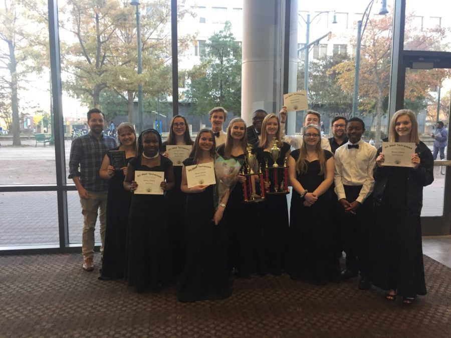 Members of the White Station choirs show off their honor choir awards.