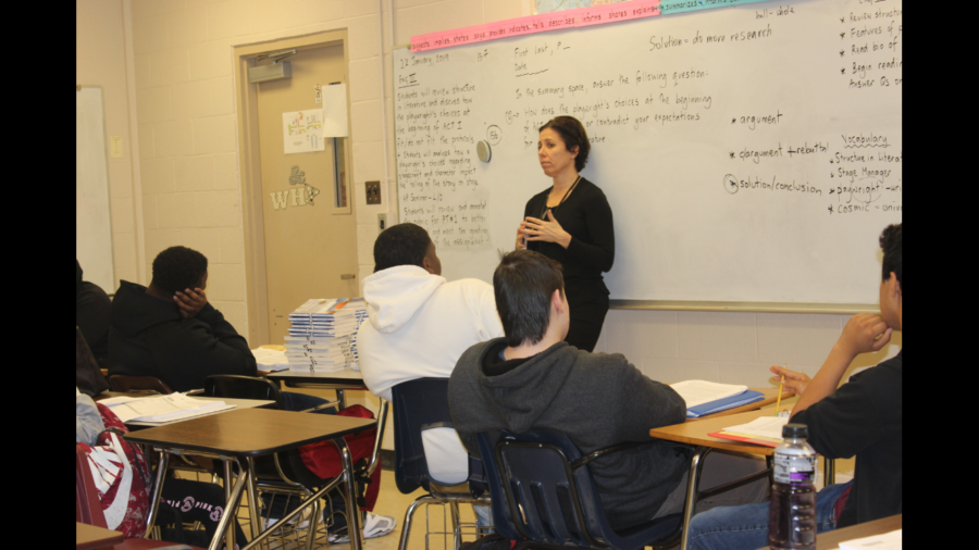 Ms. Lawrence uses the skills she learned as a lawyer to teach her English students how to analyze an argument.